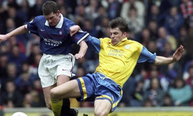 Jim Weir tackles Ian Durrant in 1998.