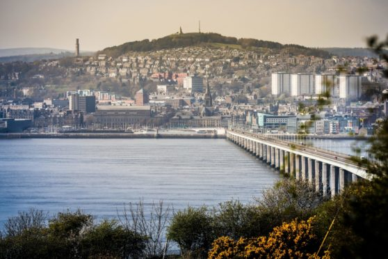 The Evening Telegraph, CR0008164, News, Dundee looking nice and picturesque in the sunshine to accompany a story on Dundee topping the list of best places to live. Picture shows; Dundee City showing the Stack, the Law and The Tay Road Bridge, from a viewpoint in Tayport. Thursday 11th April, 2019. Mhairi Edwards/DCT Media