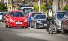 A commuter on an e-bike.
