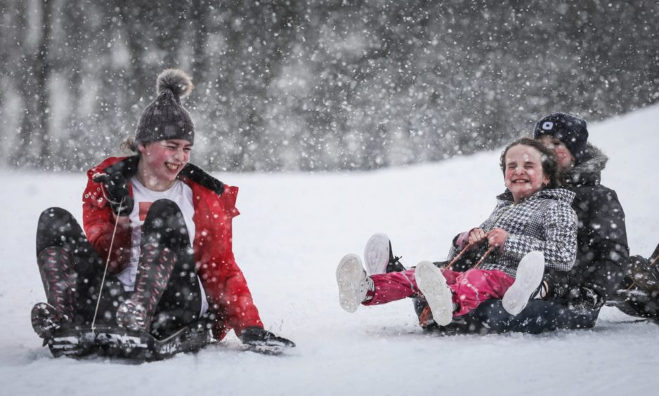 Robyn Downie with Rachel Carnegie enjoy some sledging in Caird Park.
