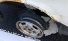 The vehicle missing a tyre was being driven on the A9 near Perth.