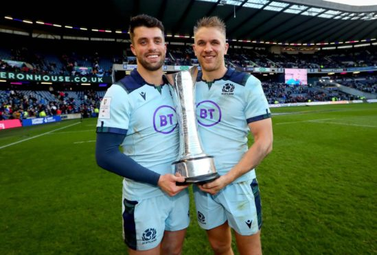 Chris Harris (r, with Adam Hastings) is looking to celebrate with The Auld Alliance trophy again. Guinness 6 Nations Round 4, BT Murrayfield, Edinburgh, Scotland - 08 Mar 2020