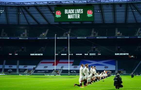 Players from both teams take the knee but others chose to stand before the Calcutta Cup game. England v Scotland, Guinness Six Nations, Rugby Union, Twickenham Stadium, London, UK - 6 Feb 2021; 12c3ef64-5059-49c3-ba2d-ce83e20cad92