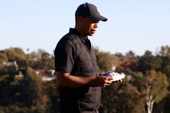 Tiger Woods at the presentation ceremony for the Genesis Invitational on Sunday.