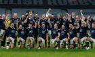 Scotland players celebrate winning the Calcutta Cup.