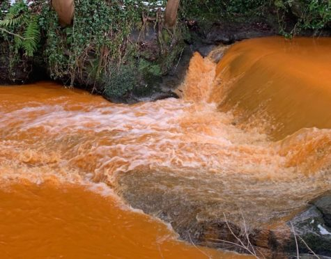 The Kinness Burn in St Andrews sparked a lot of interest when it suddenly turned orange.
