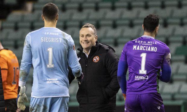 Dundee United boss Micky Mellon (centre).