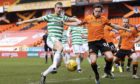 Lawrence Shankland and Celtic's Kris Ajer close in on the ball.