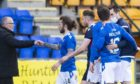 The St Johnstone players celebrate making the top six.