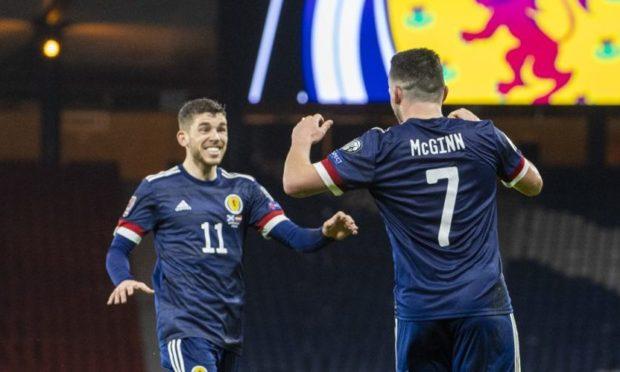 John McGinn celebrates his goal with Ryan Christie.