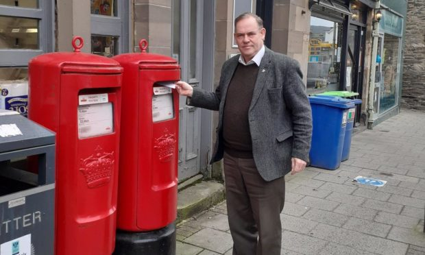 Councillor John Duff, pictured outside the sorting office in Aberfeldy