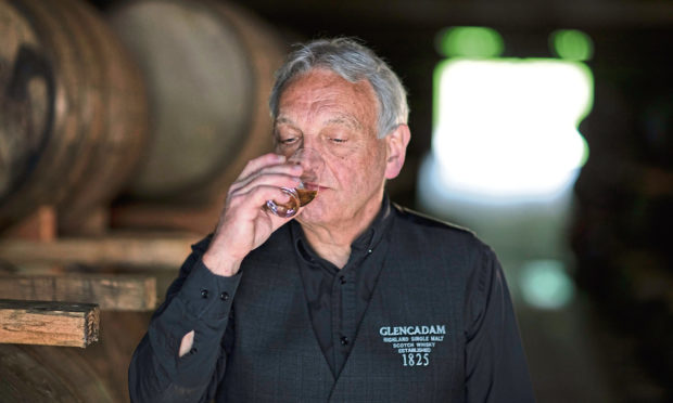 Distillery manager Doug Fitchett nosing the whisky in 1825 warehouse.