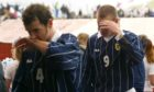Christian Dailly (left) and Kevin Kyle look inconsolable after Scotland's humiliating 2-2 draw in the Faroe Islands back in 2002.