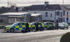 Armed police attended an incident in Cardenden on Sunday morning. Police maintained a strong presence all morning, including the premises being searched with dogs, before leaving.