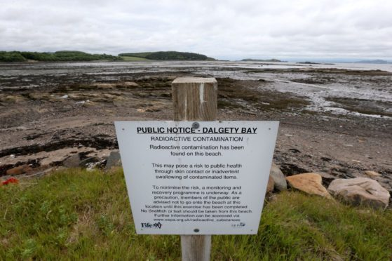 The Fife beach remains sealed off after the discovery of radioactive waste at the site.