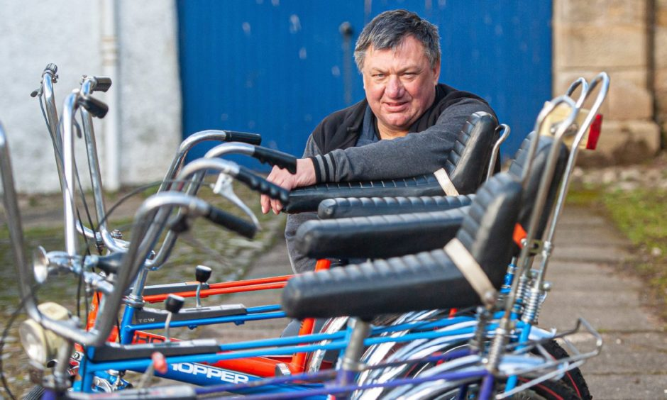 Davie Speake with some of the vintage Raleigh Chopper bikes he has carefully restored in his spare time.