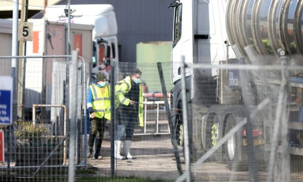 Lorries getting hosed down at the 2 Sisters factory in Coupar Angus on Wednesday morning
