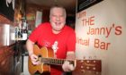 """Evening telegraph/ Courier news CR0027116   G Jennings pics ,  its one year on since"""" Jim the Janny""""  ( jimmy Young) started up his virtual bar in Menzieshill, and he talked to DCT media about the year he has had, tuesday 16th march"""