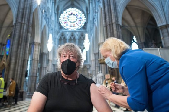 Stephen Fry receiving his vaccine in London
