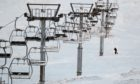 Staff check the ski lifts at Glenshee