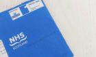 A distinctive blue Covid vaccine appointment letter.
