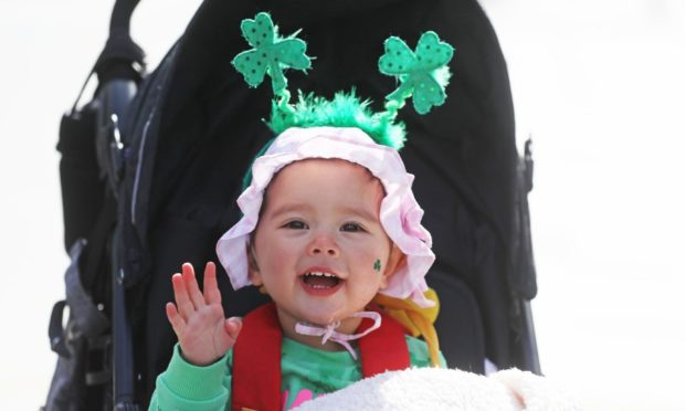 18-month-old Grace Wang dressed up to celebrate St Patrick's Day on O'Connell Street in Dublin. Picture date: Wednesday March 17, 2021. PA Photo. See PA story IRISH StPatricks. Photo credit should read: Brian Lawless/PA Wire