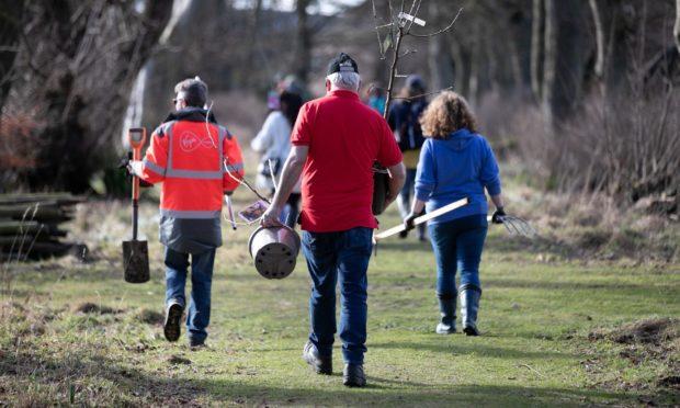 Volunteers taking part in tree planting at Hospitalfield House.