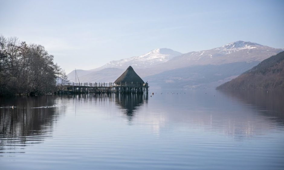 The Crannog on Loch Tay with Ben Lawers in the spring sunshine as a backdrop.