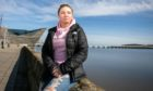 Telegraph News - Dundee - Lindsey Hamilton story - CR0027201 - Zana Grant, who has had to be rescued by the RNLI from the Tay on several occasions having jumped off the bridge and also going in from the side and also jumped off a building is talking about fighting back from chronic depression. Picture shows; Zana Grant, Discovery Point, Dundee Waterfront, Dundee, 21st March 2021, Kim Cessford / DCT Media.