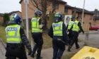 Maryfield community policing team making the raid in Maryfield