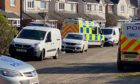 Police on the scene at Troon Avenue