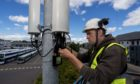 A technician with a 5G mobile mast.