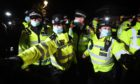 Police officers clash with people as they form a gathering in Clapham Common, London, after the Reclaim These Streets vigil for Sarah Everard was officially cancelled.