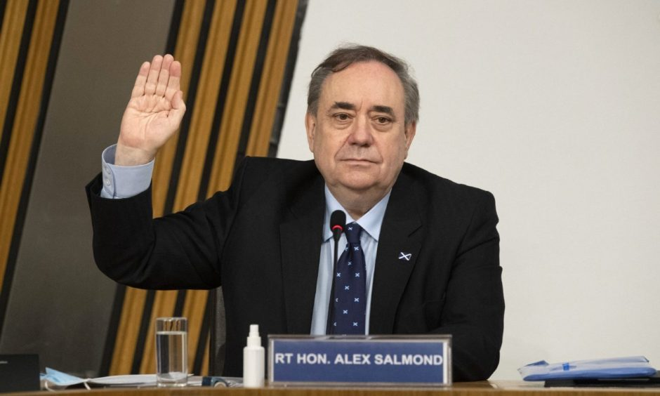 Former first minister Alex Salmond is sworn in before giving evidence to a Scottish Parliament committee examining the handling of harassment allegations him.