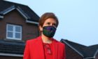 Nicola Sturgeon, leaves her home in Glasgow to head to Holyrood to give evidence to the Scottish Parliament's inquiry into her government's investigation of the former First Minister Alex Salmond.