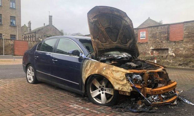 To go with story by James Simpson. A vehicle which was damaged in a blaze last year still sits within a car park. Picture shows; A damaged car.. Brown Street Dundee. James Simpson/DCT Media Date; 09/03/2021