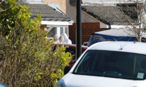 Police and forensic teams remain on the scene at Troon Avenue.