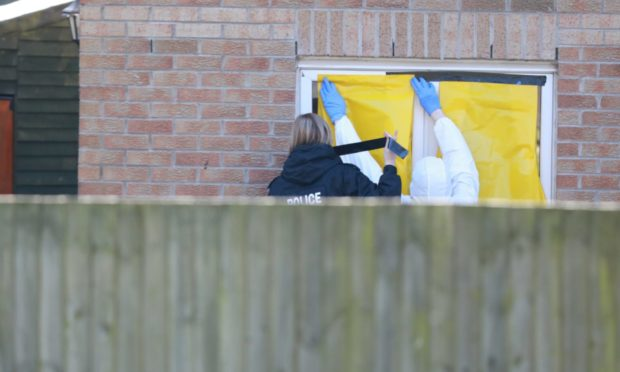 Police remain on the scene at Troon Avenue