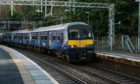 """27/2/20. Pics of a Scotrail """"320"""" model train, going through Port Glasgow train station. This is an old model of train which is still being used by Scotrail. Location: Port Glasgow."""