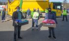 Ahmadiyya Muslim Community representatives Hassan Hakeem (left) and Saqib Ahmad (right) with driver Neil Strachan (centre) delivering healthy snacks to the Dunfermline bin crew.
