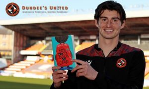 Ian Harkes with a copy of The Boy at the Back of the Class.