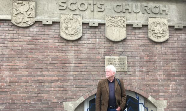 Billy Kay researching Scotland and the Low Countries outside the Scots church in Rotterdam