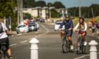 A couple enjoying a bike ride in Broughty Ferry.