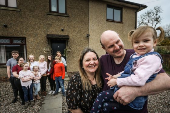 Dundee is ranked fifth best city in the UK for families. Pictured is Dundee and Scotland's biggest family. Emma and Roy Hann with the youngest of their 13 kids