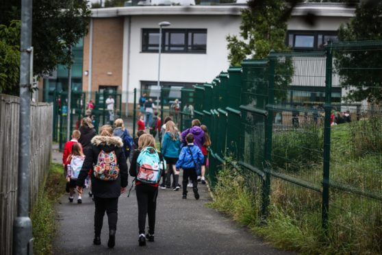 The car ban could see more children walking to school. Pictured is children walking to Blairgowrie Community Campus, last year.