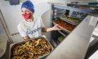 Signpost International's Caroline Bentley in the new community kitchen
