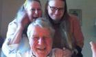 Robert, Linda and Tara when they heard the news via video call.