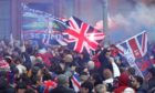Rangers fans defied restrictions to celebrate their title win at Ibrox.