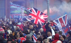Rangers fans celebrate their club winning its 55th league title.