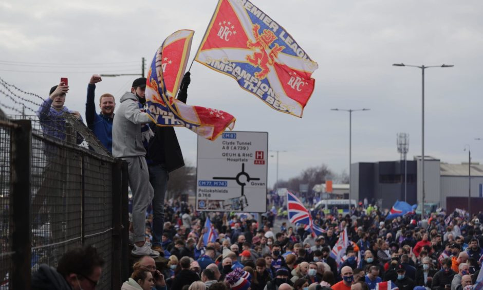 Rangers fans celebrate the Glasgow side winning the league.